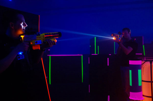 Men playing a laser tag game on an indoor field in Riga, Latvia