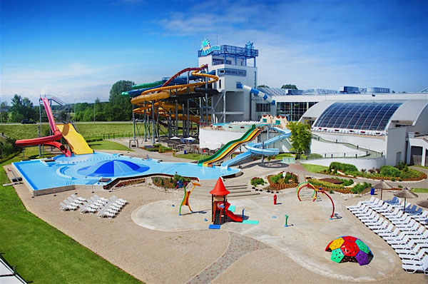 Outdoor pool and slides at a water park outdoor area in Jurmala, Latvia